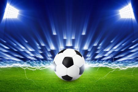 ball lightning: Soccer background, soccer ball, soccer stadium, arena in night illuminated bright spotlights, green field