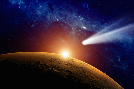Abstract scientific background - comet approaching planet Mars. Foto de archivo
