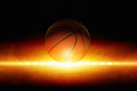 sport background: Dark sports background - basketball, bright light from glowing horizon Stock Photo