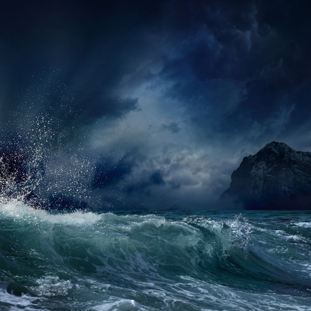 stormy sea: Dramatic nature background - big wave and dark rock in stormy sea, stormy weather