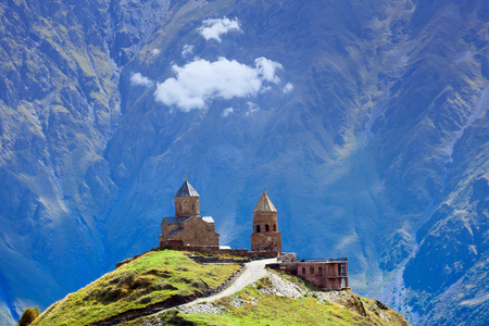 Gergeti christian church near Kazbegi, Stepancminda village in Georgia, Caucasus.