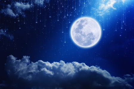 Full moon in night sky with falling stars and mysterious light from above
