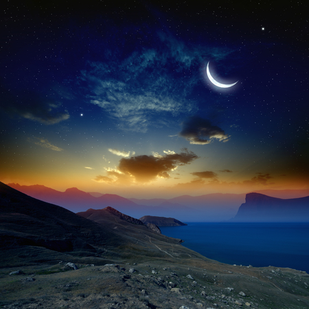 Beautiful sunrise in mountains and sea, glowing horizon, moon and bright stars in dark blue sky. Elements of this image furnished by NASA http://visibleearth.nasa.gov Stockfoto