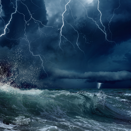 stormy sea, dark clouds with bright lightnings
