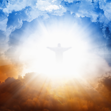 Christ silhouette in sky , bright light from heaven, blue and red clouds