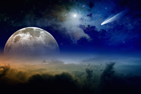 Glowing clouds, full moon rise, stars and comet in dark blue sky.  Stock Photo