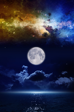 Full moon in night sky, mysterious glowing horizon over dark blue sea, nebula and stars in space. Elements of this image furnished by NASA nasa.gov