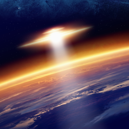 Abstract fantastic background - ufo with bright spotlight approaches glowing planet Earth in space. Elements of this image furnished by NASA nasa.gov