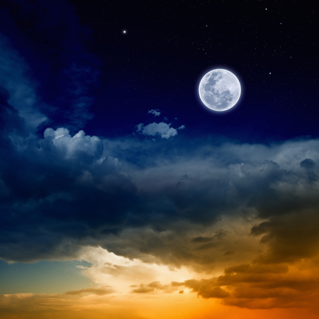 Beautiful nature background - red glowing sunset, full moon and stars Stock Photo