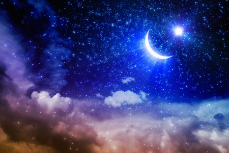Ramadan Kareem background with shining moon and stars above pink clouds, holy month.  Stock Photo