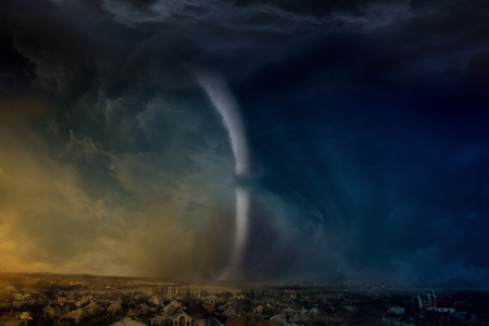 force of the nature: Nature force background - huge tornado destroys small town, dark stormy sky