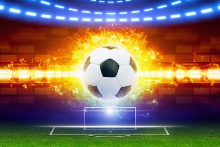pelota de futbol: Resumen de fondo de fútbol - la quema de balón de fútbol, ??balón de fútbol en el fuego, portería de fútbol en el campo verde, evento deportivo mundial