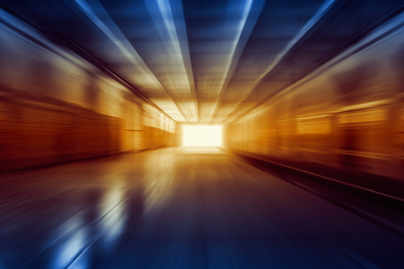 light at the end of tunnel: Bright glowing light in end of tunnel Stock Photo