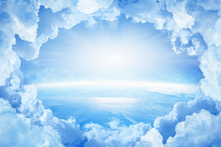 Light from heaven, blue planet Earth in white clouds, bright sunlight from above. Elements of this image furnished by NASA nasa.gov Stock Photo