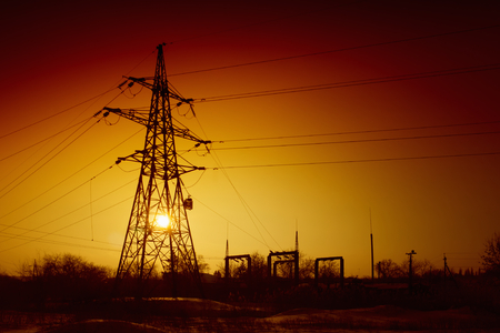 blacking: Power lines on sunset, electrical power supply, blackout concept, red sky Stock Photo