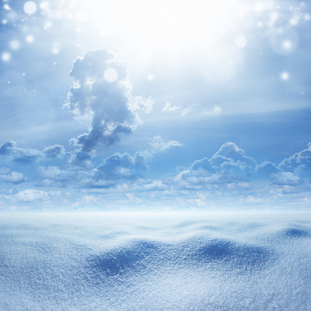 cloud capped: Winter seasonal background - snowy landscape, cold weather with snow, bright sunshine in blue sky