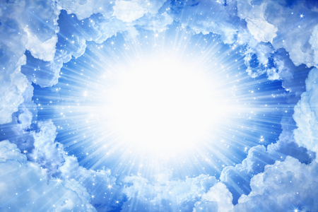 Beautiful peaceful background - beautiful blue skies with bright light from above, light from heaven Stockfoto
