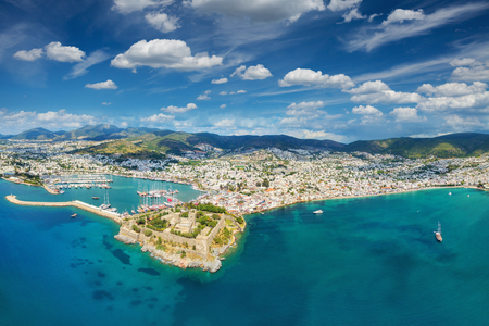water town: Aerial view from drone of resort town Bodrum in Turkey. Beautiful blue sky with white clouds, blue sea with clear water
