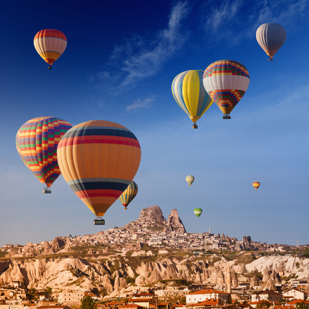 Hot air balloons flying in ancient town of Cappadocia, Turkey