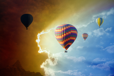 approaches: Dramatic background - dark stormy clouds approaches to flying hot air balloons Stock Photo