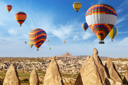 ballooning: Hot air ballooning is most amazing attraction and adventure in Kapadokya. Colorful hot air balloons flying above unusual rocky landscape in Cappadocia, Turkey