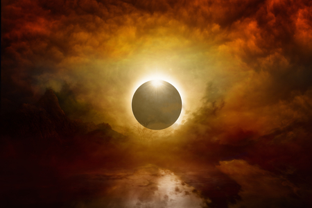 Dramatic apocalyptic background - full solar eclipse in dark red sky, end of world, judgment day coming. Elements of this image furnished by NASA Stockfoto