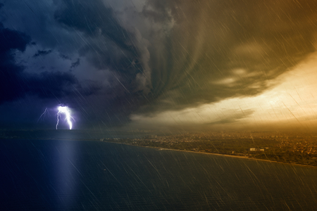 Weather forecast concept background, bright powerful lightning, huge thunderbolt struck seaside city, dangerous climate change concept Stock fotó - 60468994