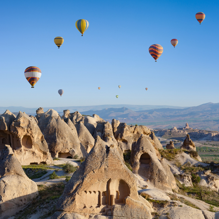 hand carved: Hand carved rooms in unusual rock formation in Goreme, Cappadocia, Turkey. Hot air ballooning in morning is most amazing attraction in Kapadokya. Stock Photo