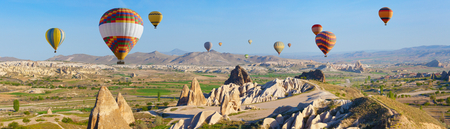 Panoramic view of unusual rocky landscape in Cappadocia, Turkey. Hot air ballooning in morning is most amazing attraction in Kapadokya. Stok Fotoğraf
