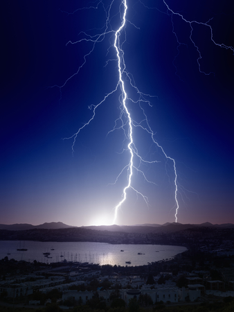 Weather background - bright powerful lightning, huge thunderbolt struck mountain near small seaside city