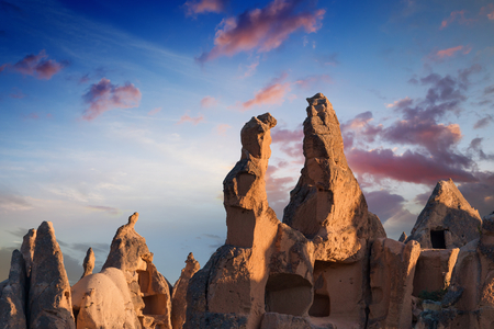 hand carved: Hand carved rooms in unusual rock formation illuminated by the rising sun in Goreme, Cappadocia, Turkey