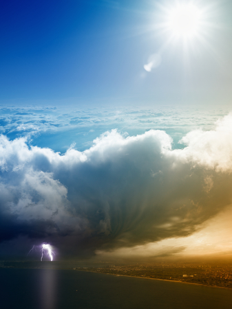 struck: Weather forecast concept - variety weather conditions, bright sun and blue sky, huge thunderbolt struck seaside city, dangerous climate change concept