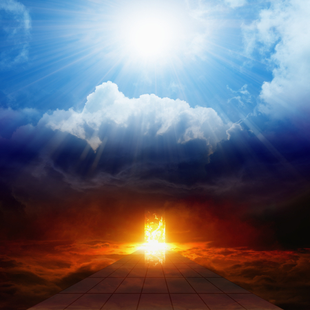 Dramatic religious background - bright light from heaven, burning doorway in dark red sky, road to hell, way to hell, heaven and hell 스톡 콘텐츠