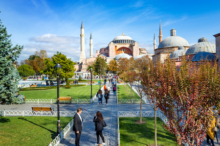 Istanbul, Turkey - October 25, 2016: Sultanahmet district of Istanbul, Turkey. Green grass field and fountain near famous landmark Hagia Sophia.