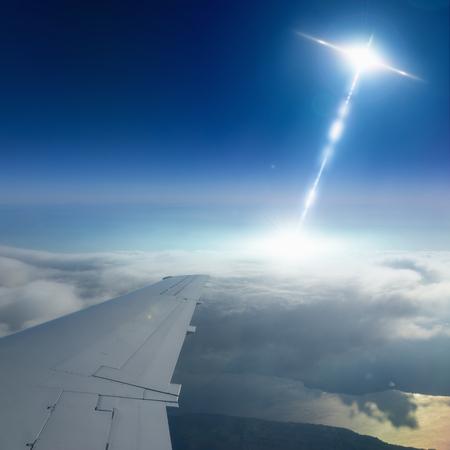 higher intelligence: Abstract sci-fi background - ufo flies near airplane in dark blue sky