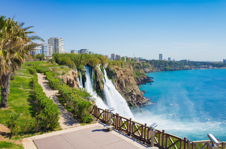 Aerial view of Lower Duden waterfall in Antalya, Turkey. Water cascading 40 meters from platform into Mediterranean sea in sunny summer day.