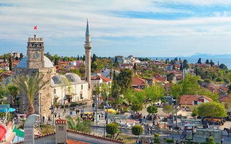 Antalya, Turkey - April 10, 2017: Clock Tower in sunset time in old city Kaleici district of Antalya, Turkey