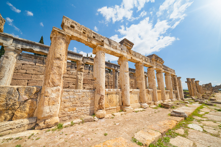 Wide angle view of latrine along Frontinus Street at Hierapolis ancient city adjacent to modern Pamukkale in Turkey Stock Photo