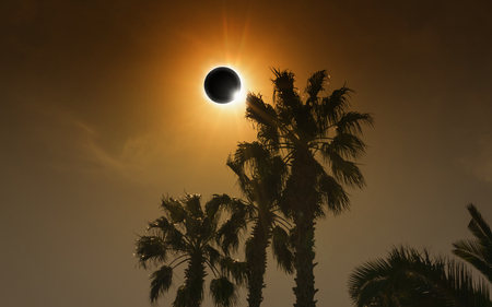 Total solar eclipse in dark red glowing sky, amazing natural phenomenon when Moon passes between planet Earth and Sun