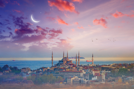 Famous landmark Blue Mosque, beautiful glowing sunset with crescent in Istanbul, Turkey.
