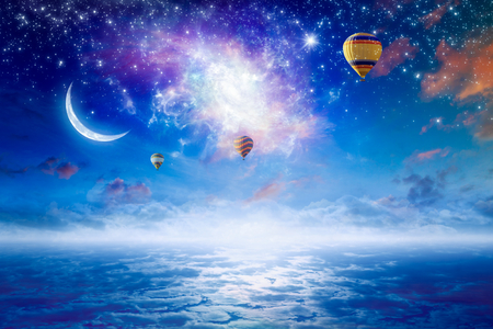 Tranquil heavenly picture - colorful hot air balloons flying in blue starry sky with bright stars, new moon and twisted galaxy