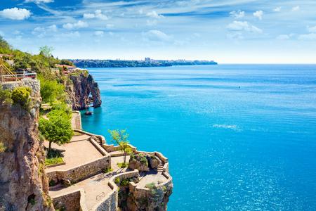 Viewing and resting terrace on slope of cliff near beautiful blue Gulf of Antalya in popular seaside resort city Antalya, Turkey Stock Photo
