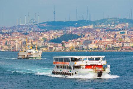 Istanbul, Turkey - April 24, 2017: Istanbul cityscape, passenger ferries cross strait of Bosphorus.