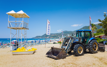Alanya, Turkey - June 23, 2017: Tractor is on beach after cleaning coast from garbage in popular seaside resort city Alanya, Turkey