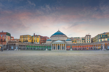 Sunset view enlightened with color of Italian flag San Francesco di Paola church located at Piazza del Plebiscito in Naples, Italy Stock Photo