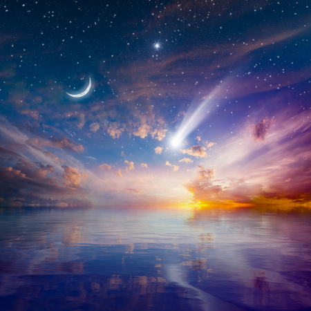 Amazing peaceful background - beautiful glowing sunset with falling comet - mystical sign in sky, rising crescent moon and stars. Elements of this image furnished by NASA