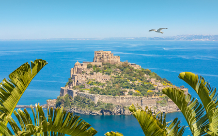 Daytime view of Aragonese Castle or Castello Aragonese - famous landmark and tourist destination near Ischia island, Italy.