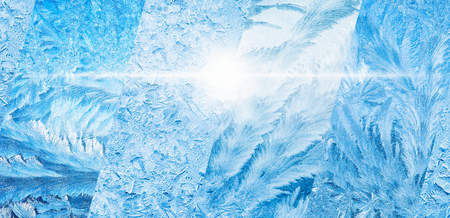 Wide blue winter background, collage of frozen icy windows, cold sunny weather, bright sun shines through frozen window, weather forecast concept Standard-Bild