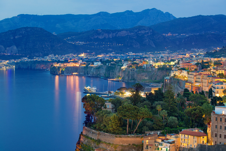 Sunset view of cliff coastline Sorrento and Gulf of Naples - popular tourist destination in Italy.