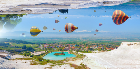 Amazing fantastic unreal world, hot air balloons fly in blue sky between white Pammukale travertines, Turkey